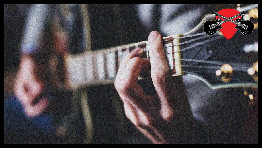 Man strumming guitar chords