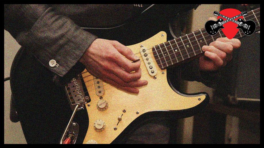 Guitarist plays lead guitar