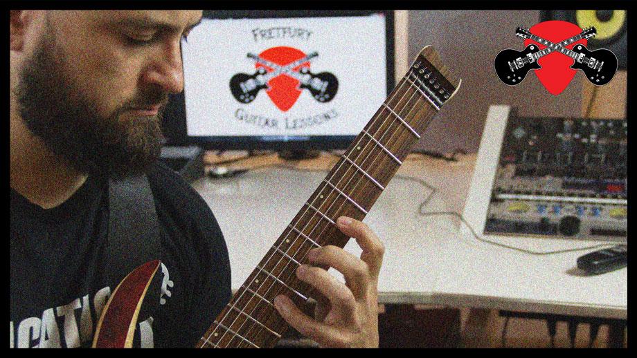 Sergio R. Klein fretting notes on his guitar
