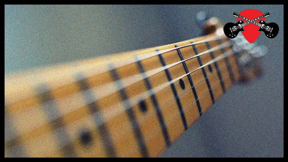 Image of guitar fretboard looking down the strings towards headstock