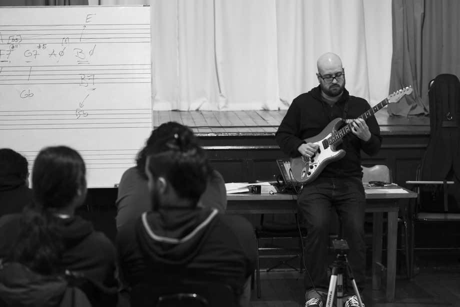 Sergio teaching a guitar class